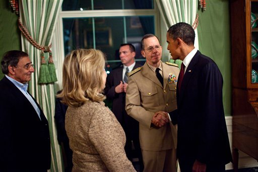 In this image released by the White House, President Barack Obama shakes hands with Adm. Mike Mullen, Chairman of the Joint Chiefs of Staff, in the Green Room of the White House in Washington Sunday, May 1 after his address to the country.