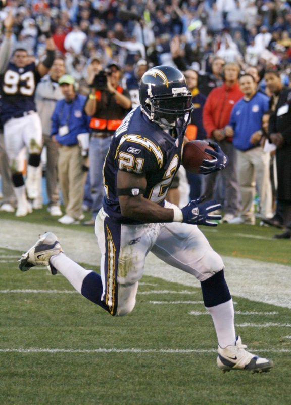 In this Dec. 10, 2006, file photo, San Diego Chargers running back LaDainian Tomlinson turns the corner on a seven-yard touchdown, setting the NFL single-season record.