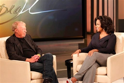 """This photo taken April 22, 2011, and provided by Harpo Productions Inc., shows talk-show host Oprah Winfrey interviewing Nike CEO Phil Knight during taping for an episode of """"The Oprah Winfrey Show"""" at Harpo Studios in Chicago."""
