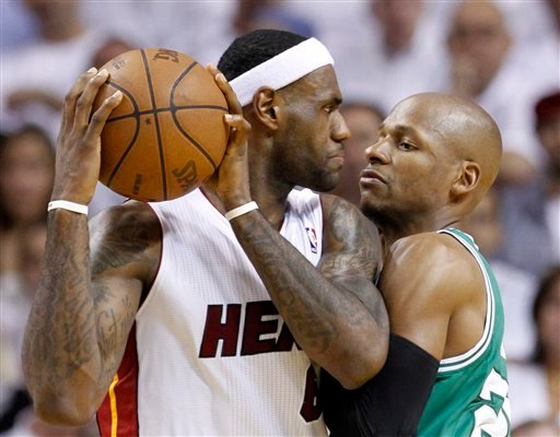 Miami Heat's LeBron James, left, prepares to drive against Boston Celtics' Ray Allen during the first half of Game 2 of a second-round NBA playoff basketball series, Tuesday, May 3, 2011 in Miami.