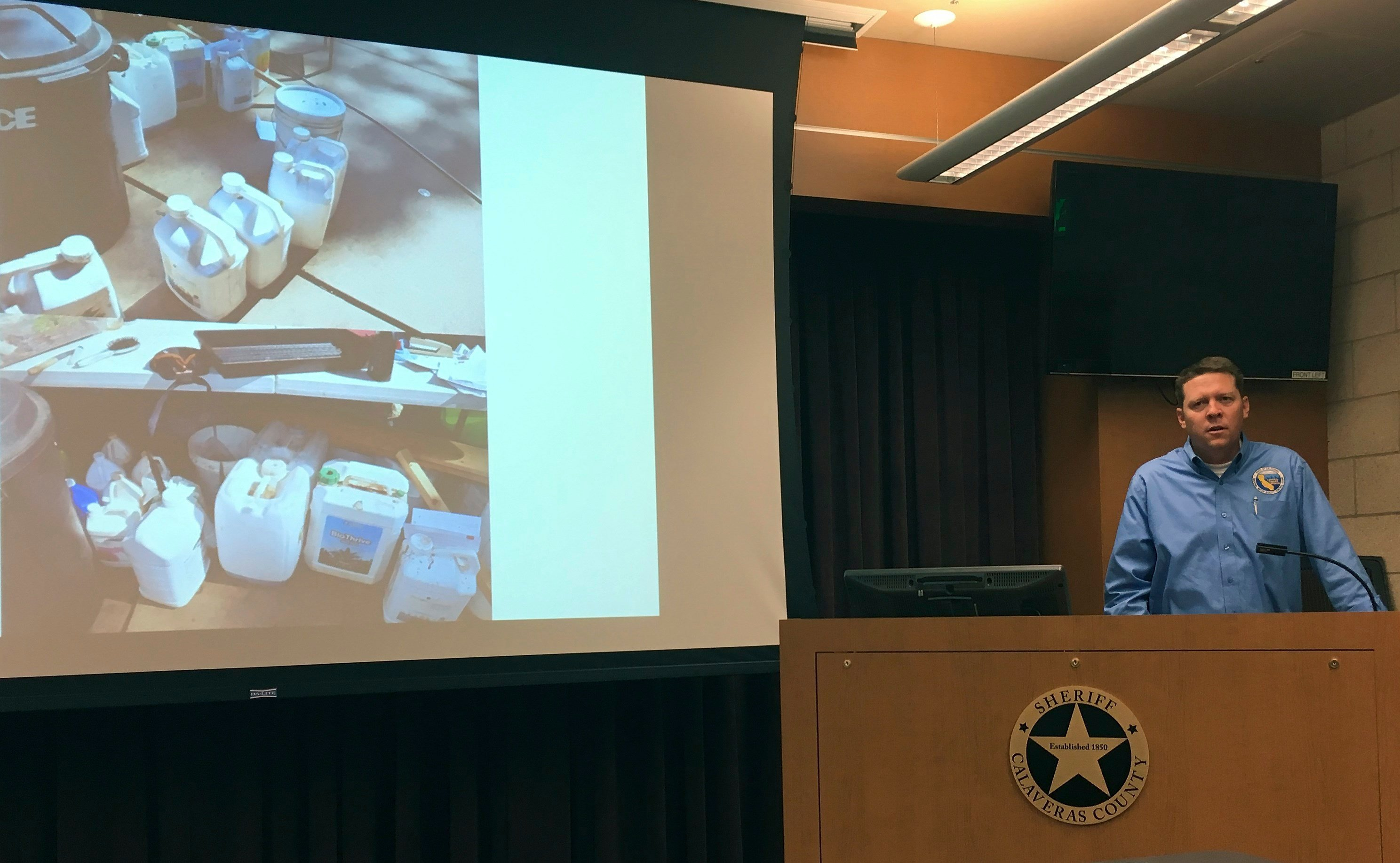 Clint Snyder, assistant executive officer of the Central Valley Regional Water Quality Control Board, speaks about environmental damage from illegal marijuana farms at the Calaveras County Sheriff's office on Thursday. (AP Photo/Kathleen Ronayne)