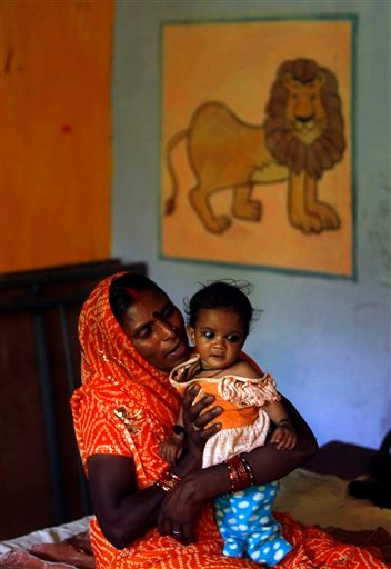 In this photo taken Wednesday, April 13, 2011, awoman sits with her malnourished baby girl at a ward for malnourished children, where nine out of ten children are girls, at a government hospital in Morena in the Central Indian State of Madhya Pradesh.