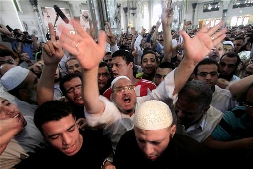 Egyptian Islamist groups chant anti-American slogans as they protest the killing of al-Qaida leader Osama Bin Laden, following the Friday prayer in the Nour mosque in Cairo, Egypt, Friday, May 6, 2011.