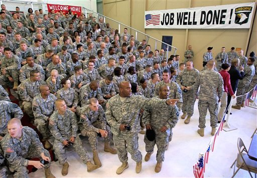Soldiers arrive in a hangar to hear an address by President Barack Obama at Fort Campbell, Ky., Friday, May 6, 2011. Obama is coming to Fort Campbell to address soldiers who have recently returned from Afghanistan.