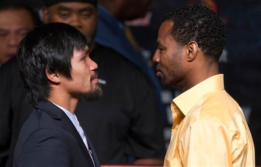 Manny Pacquiao, left, and Shane Mosley pose for photos after a news conference, Wednesday, May 4, 2011, in Las Vegas. Mosley will challenge Pacquiao for his WBO welterweight title on Saturday.