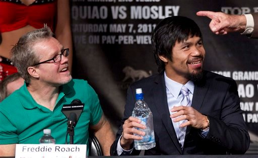 Manny Pacquiao, right, and his trainer Freddie Roach react to a comment by promoter Bob Arum during a boxing press conference, Wednesday, May 4, 2011, in Las Vegas.