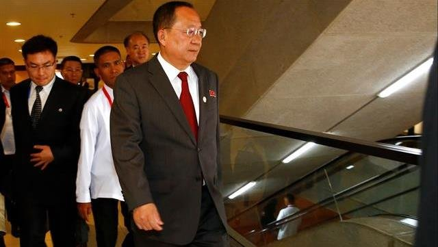 North Korean Foreign Minister Ri Yong-ho walks toward an escalator during ongoing meetings at the Philippine International Convention Center.