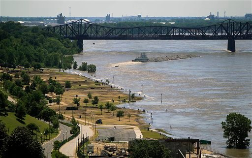 A tugboat heads under the Harahan Bridge in Memphis, Tenn., next to Tom Lee Park which is beginning to be flooded by the Mississippi River on Friday, May 6, 2011. (AP Photo/Lance Murphey)