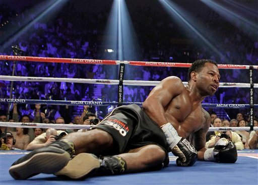 Shane Mosley lays on the mat after being knocked down by Manny Pacquiao in the third round.