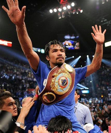 Manny Pacquiao celebrates after defeating Shane Mosley by unanimous decision.