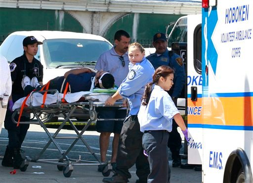 An unidentified man, who was injured during a PATH train crash at the Hoboken Terminal, is seen on a stretcher as medical officials prepared to take him to the hospital, Sunday, May 8, 2011, in Hoboken, N.J. (AP Photo/Julio Cortez)