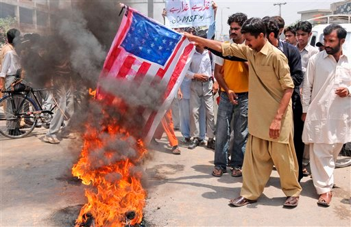 Supporters of Pakistan's Muslim League burn a representation of the U.S flag, during an anti American demonstration in Multan, Pakistan, Monday, May 9, 2011.