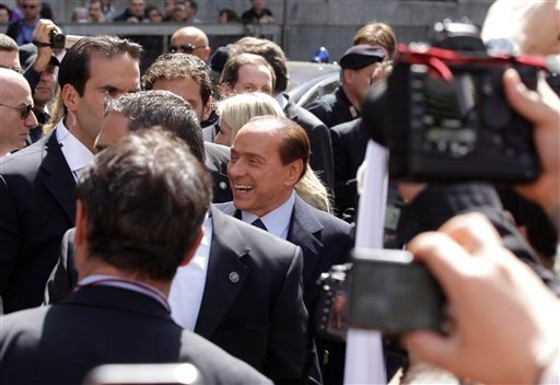 Italian Premier Silvio Berlusconi, center, speaks to his supporters outside Milan's courthouse where he attended his trial on tax fraud charge, Italy, Monday, April 11, 2011.