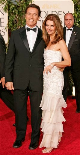 In this Jan. 16, 2005 file photo, California Gov. Arnold Schwarzenegger arrives with wife Maria Shriver for the 62nd Annual Golden Globe Awards in Beverly Hills, Calif.