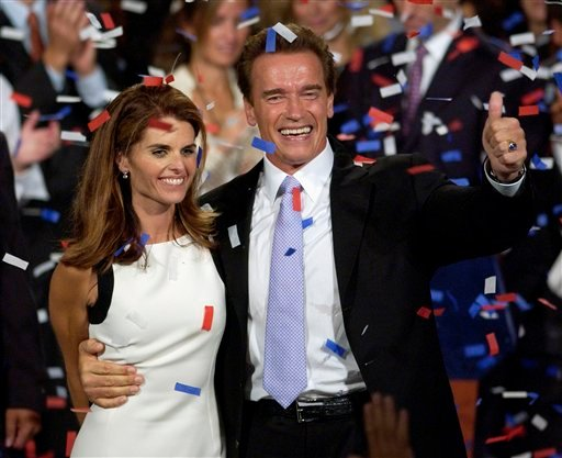 This file photo taken Oct. 7, 2003, shows Arnold Schwarzenegger and his wife, Maria Shriver ,as they celebrate his victory in the California gubernatorial recall election in Los Angeles.