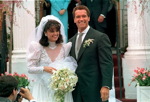 In an April 25, 1986 file photo Actor Arnold Schwarzenegger poses with his bride Maria Shriver following their wedding ceremony in Hyannis, Mass.