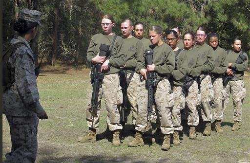 FILE - In this Feb. 21, 2013 file photo, female recruits stand at the Marine Corps Training Depot on Parris Island, S.C.  (AP Photo/Bruce Smith, File)