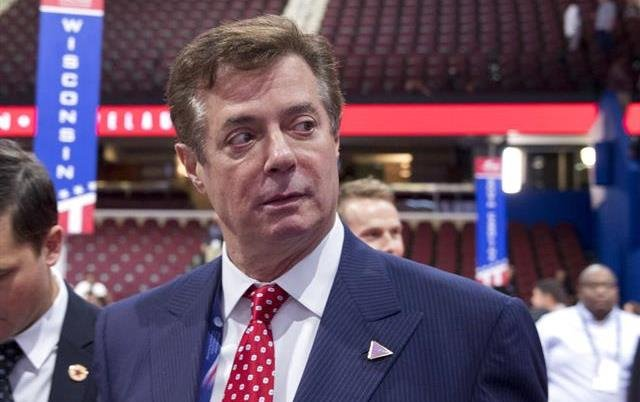 Then-Trump campaign chairman Paul Manafort walks around the convention floor before the opening session of the Republican National Convention in Cleveland.
