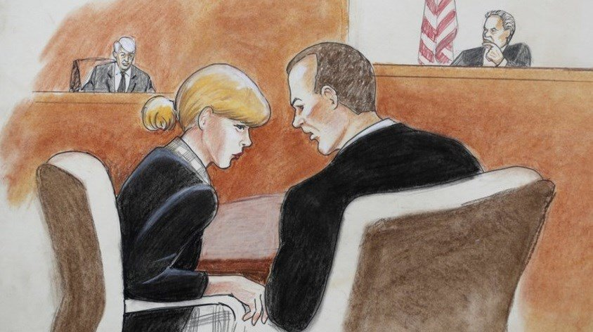 Taylor Swift, front left, confers with her attorney as David Mueller, back left, and the judge look on during a civil trial in federal court Tuesday, Aug. 8, 2017, in Denver.