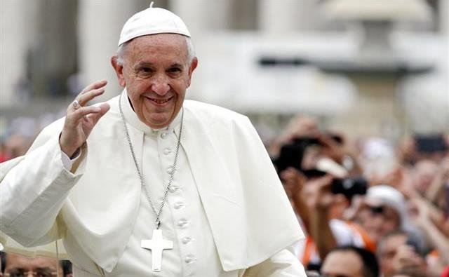 Pope Francis arrives for his weekly general audience, in St.Peter's Square, at the Vatican.