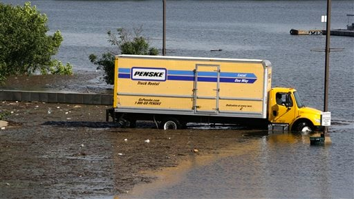 In this May 5, 2011 photo, staff of the Lighthouse Point Casino in Greenville, Miss., drive a truck away from the loading dock through Lake Ferguson floodwaters.