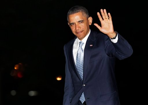 President Barack Obama waves to media as he walks from Marine One to the White House, Wednesday, May 11, 2011, in Washington, as he travels from Texas.