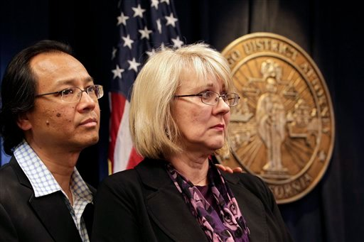 Fred and Kathy Santos, the parents of stabbing victim Luis Santos, listen during a news conference Wednesday, May 11, 2011, at the district attorney's office in San Diego.