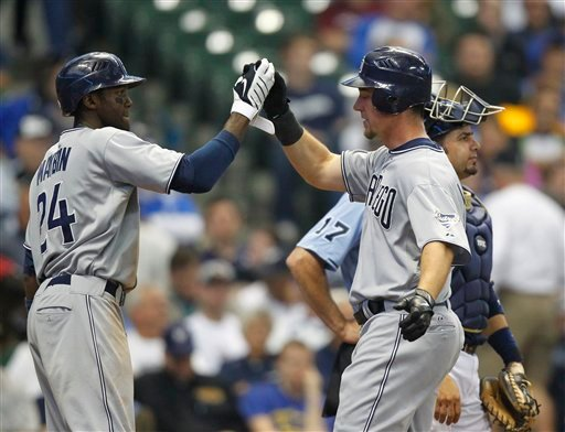 San Diego Padres' Ryan Ludwick, center, receives a high-five from Cameron Maybin (24) after hitting a two-run home run in the eighth inning of a baseball game against the Milwaukee Brewers, Wednesday, May 11, 2011, in Milwaukee.