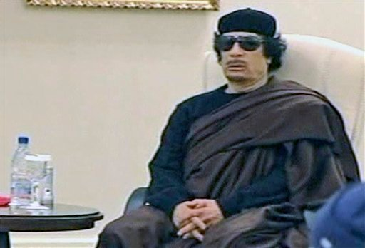 In this image made from Libyan TV, Libyan leader Moammar Gadhafi holds a meeting with tribal leaders from eastern Libya, in Tripoli, Libya, Wednesday, May 11, 2011.