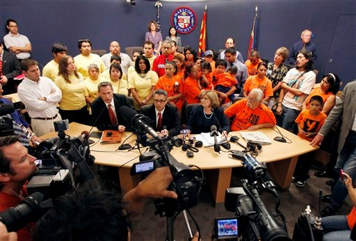 Critics gathered and called for the resignation of Maricopa County Sheriff Joe Arpaio while asking the U.S. Attorney's Office to place the sheriff's office into receivership.