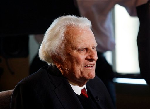 FILE- In this Dec. 20, 2010 file photo, evangelist Billy Graham, 92, is interviewed at the Billy Graham Evangelistic Association headquarters in Charlotte, N.C.