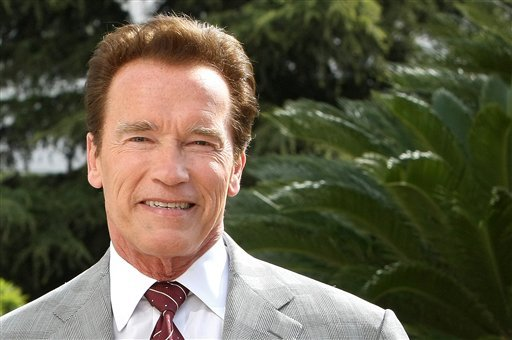FILE - In this April 4, 2011 file photo, Austrian-American actor and former Governor of California, Arnold Schwarzenegger, poses for photographers during the International Television Programme Market (MIPTV) in Cannes, southern France.