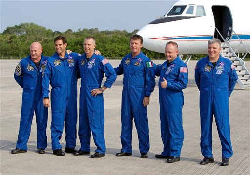 The astronauts of space shuttle Endeavour gather for a photo after arriving at the Kennedy Space Center in Cape Canaveral, Fla., Thursday, May 12, 2011.