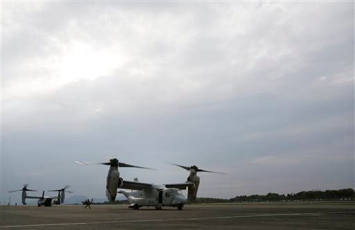 Two MV-22 Osprey aircraft of the U.S. Marine Corps sit on the tarmac at the Takayubaru vice camp in earthquake-hit Mashiki, Kumamoto prefecture, southern Japan, April 18, 2016. (Koji Ueda/AP Photo)
