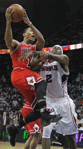 Chicago Bulls point guard Derrick Rose (1) goes to the basket as Atlanta Hawks shooting guard Joe Johnson (2) defends in the third quarter of Game 6 of an NBA basketball Eastern Conference semifinal playoff series.