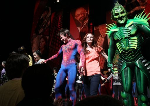 "Patrick Page, right, Jennifer Damiano, second from right, Reeve Carney, second from left, and T.V. Carpio, left, react to audience applause during the curtain call for ""Spider-Man: Turn Off The Dark""."