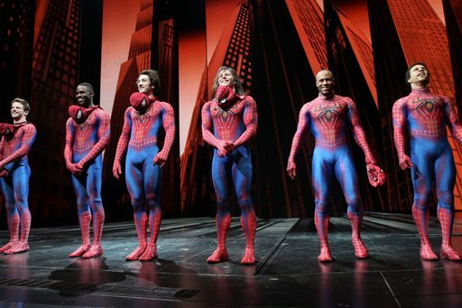 """Christopher Tierney, third from right, and other Spider-Men, react to audience applause during the curtain call for """"Spider-Man: Turn Off The Dark"""" at the Foxwoods Theatre in New York following the first preview performance of the revamped show."""
