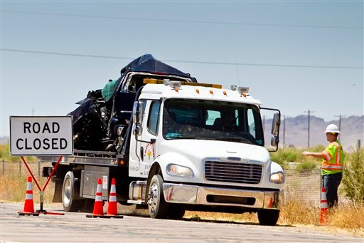 The wreckage of the Border Agents' SUV is removed from the accident scene Thursday, May 12, 2011 in Gila Bend, Ariz.