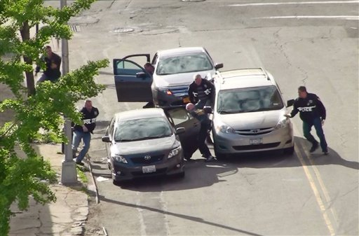 In this photo released by the New York City Police Department, police intercept a vehicle carrying two Americans who allegedly bought guns and a grenade to launch an attack on a New York synagogue, Wednesday, May 11, 2011.