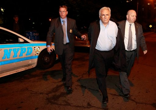 International Monetary Fund leader Dominique Strauss-Kahn, center, is brought into the Municipal Court, Monday, May 16, 2011 in New York. Strauss-Kahn is accused of sexually assaulting a maid in his hotel room. (AP Photo/Julio Cortez)
