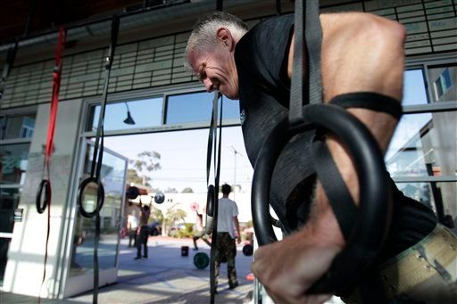 In this May 12, 2011 photo, Joe Stumpf works out with rings during a workout designed to mirror a US Navy SEAL training at the SEALFIT exercise center in Encinitas, Calif.