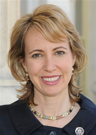 In this March 2010 file photo provided by the office of Rep. Gabrielle Giffords, D-Ariz., Giffords poses for a photo.