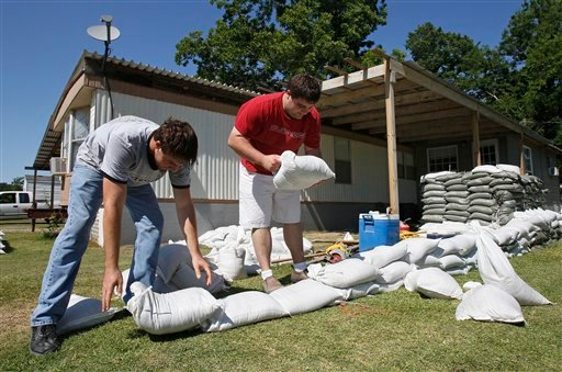 Ty Fontenot, left, and his brother Aron build a wall of sand bags around their home in Krotz Springs, La., Sunday, May 15, 2011, in advance of forecasted flooding of the Mississippi river brought on by the opening of the Morganza Spillway north of town.