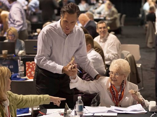 Mitt Romney, left, greets supporters during a phone bank fundraiser, Monday, May 16, 2011, in Las Vegas.