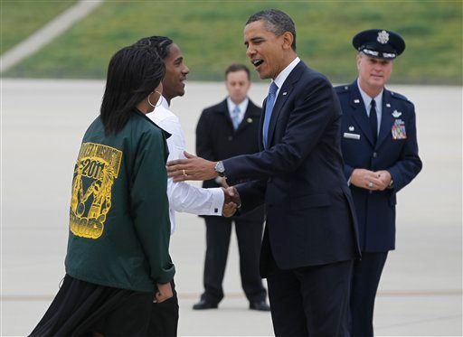 President Barack Obama is greeted by Booker T. Washington High School students Cassandra Henderson, left, and Christopher Dean, after stepping off Air Force One in Memphis, Tenn., Monday, May 16, 2011.