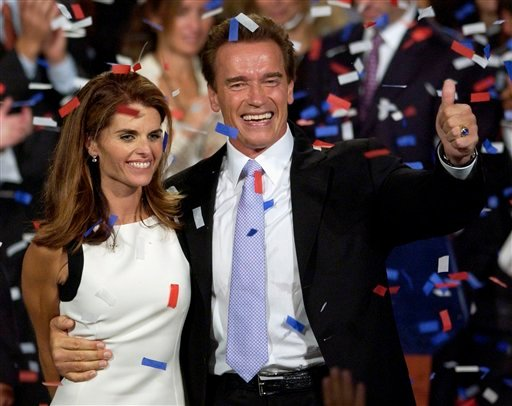 FILE - This file photo taken Oct. 7, 2003, shows former California Governor Arnold Schwarzenegger and his wife, Maria Shriver, as they celebrate his victory in the California gubernatorial recall election in Los Angeles.