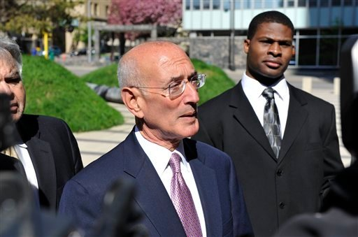 Michael Hursfeld, center, speaks and Shawn Stuckey, right, listens, as the two attorneys for retired NFL football players, address the media outside the federal courthouse (AP Photo/Jim Mone)