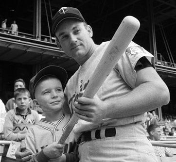 This Sept. 12, 1964, file photo shows Minnesota Twins' Harmon Killebrew posing with 9-year-old Johnny Guiney, at New Yorks Yankee Stadium. (AP Photo/Harry Harris, File)