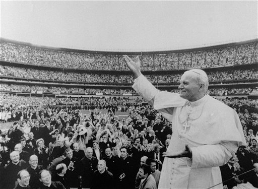 In this Oct. 3, 1979 file photo, Pope John Paul II gestures to the crowd at New York's Shea Stadium. (AP Photo/File)