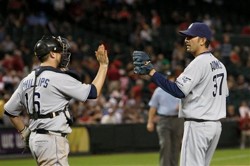 San Diego Padres' Mike Adams (37) celebrates the final out with teammate San Diego Padres' Kyle Phillips (16) after the ninth inning of an MLB baseball game against the Arizona Diamondbacks Monday, May 16, 2011, in Phoenix. (AP Photo/Ross D. Franklin)